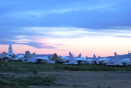 hundreds of retired military planes at sunset