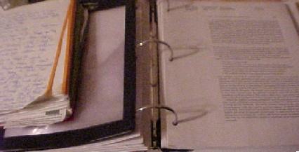 a textbook and one of my Mages notebooks.